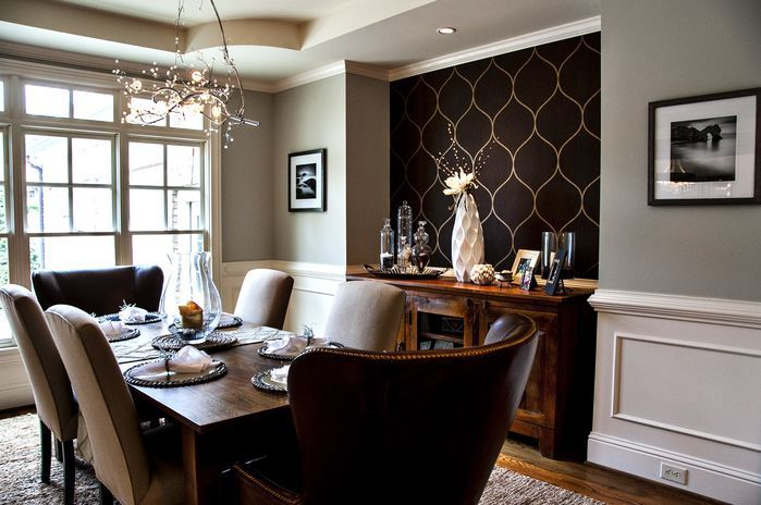 In this neutral dining room, the black wallpaper accent