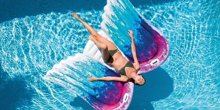 Float Your Way Into Summer On This Giant Angel Wings Pool Float Cute Pool Floats Cool Pool Floats Pool Float