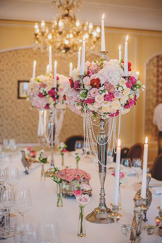 Elegant Tall Candelabra Centerpieces Decorated With Roses