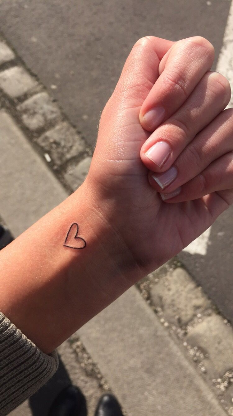 Heart Outline Wrist Tattoo