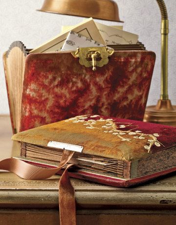 Revamp a boring accordion file by encasing it in a beautiful vintage photo album.