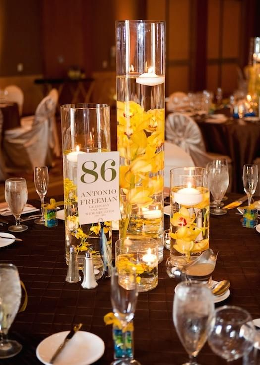 yellow flower floating candle centerpieces with black rocks google