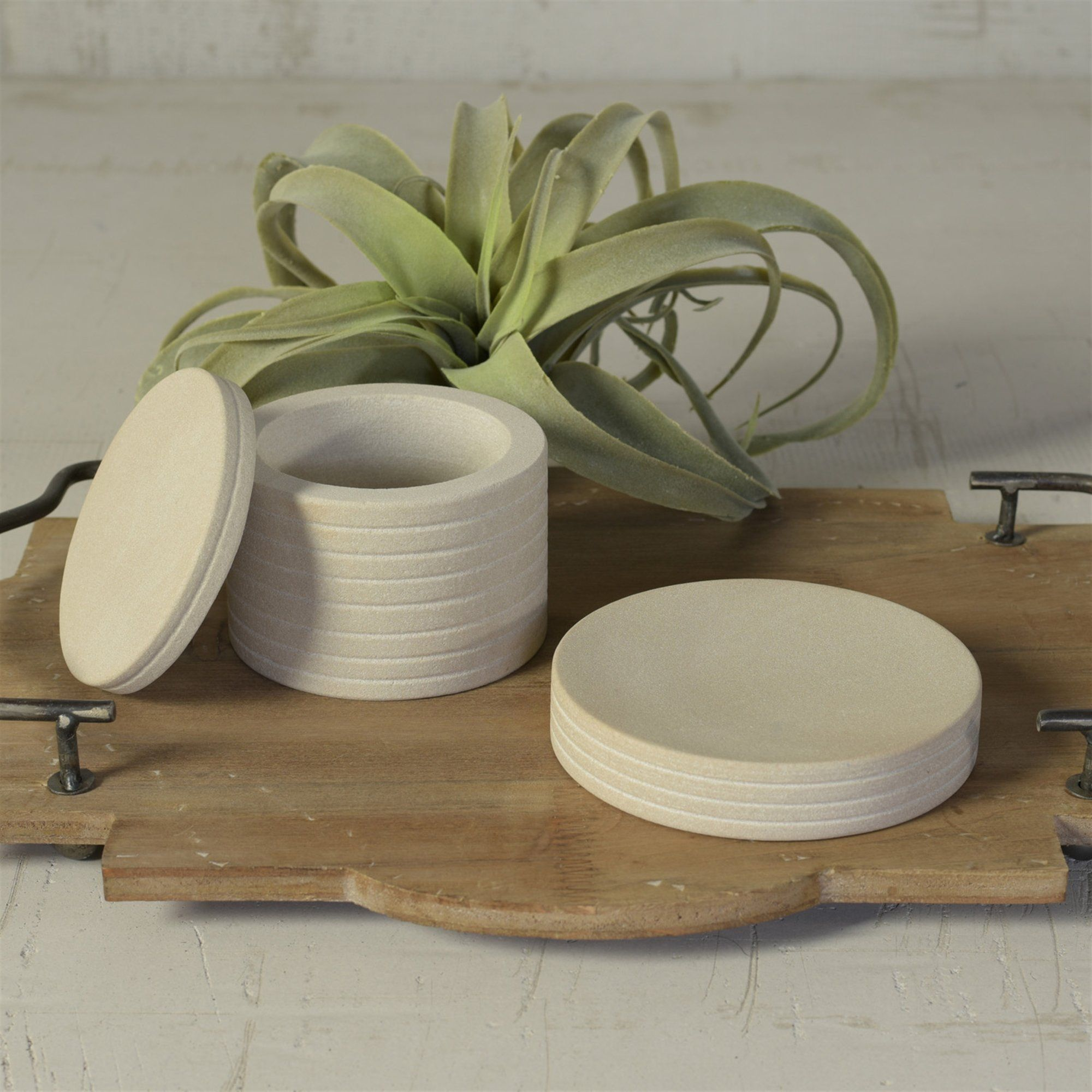 Cool sandstone features a subtle stripe in this ever-versatile soapdish. Dimensions: 5 x 5 x 1 Material: marble stone