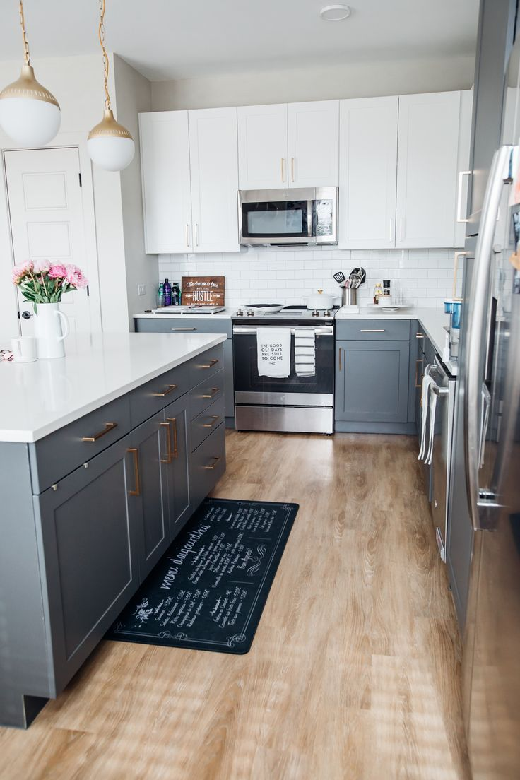 two tone kitchen cabinets with gold hardware in a dallas home in 2020 kitchen decor on kitchen remodel gold hardware id=75462