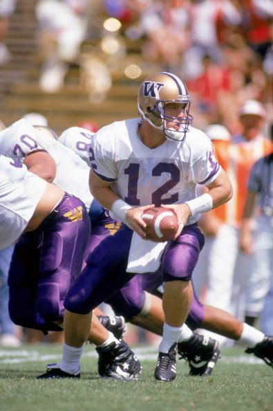 f188cf267 Quarterback Billy Joe Hobert of the Washington Huskies looks for the hand  off against the Stanford Cardinals at Stanford Stadium in September 7 1991.