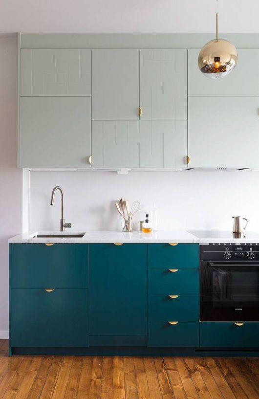 mint and teal kitchen cabinets with gold pendant light fixture