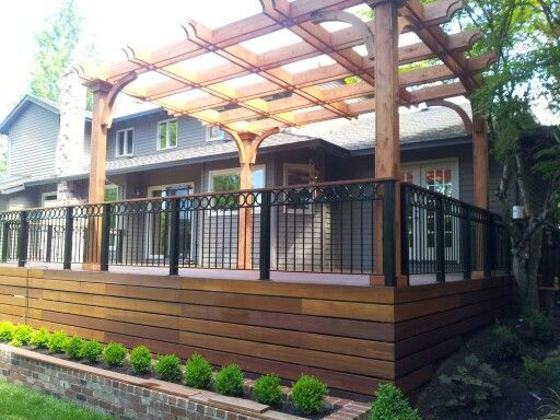 Red Balau Deck With Wrought Iron Railing And Cedar Pergola