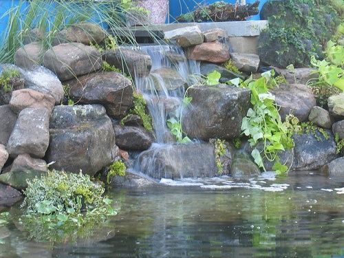 Waterfalls for ponds pictures with round rocks found on for Koi pond rocks