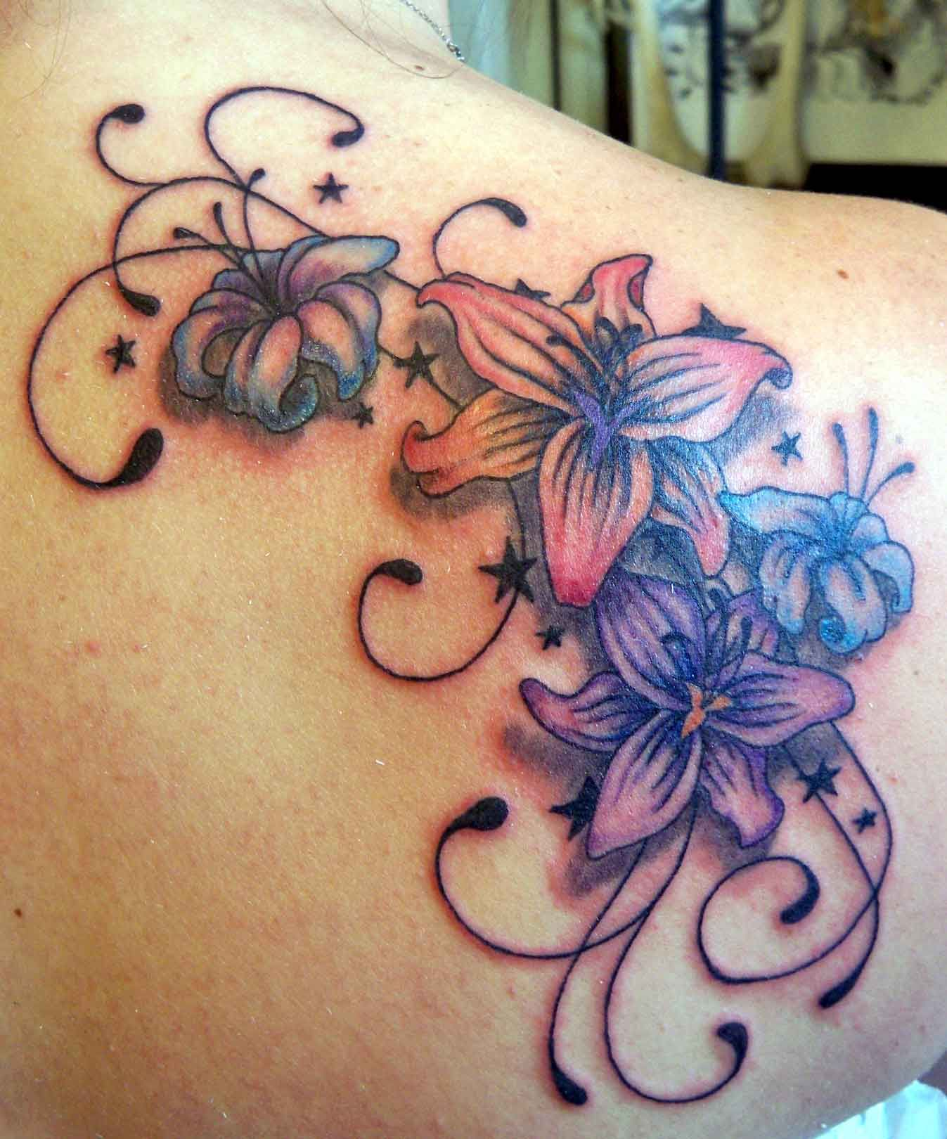 Colorfull Flowers With Bold Swirls On Shoulder Tattoo