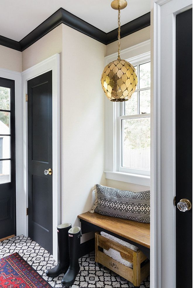 Farmhouse Mudroom with black door black trim black
