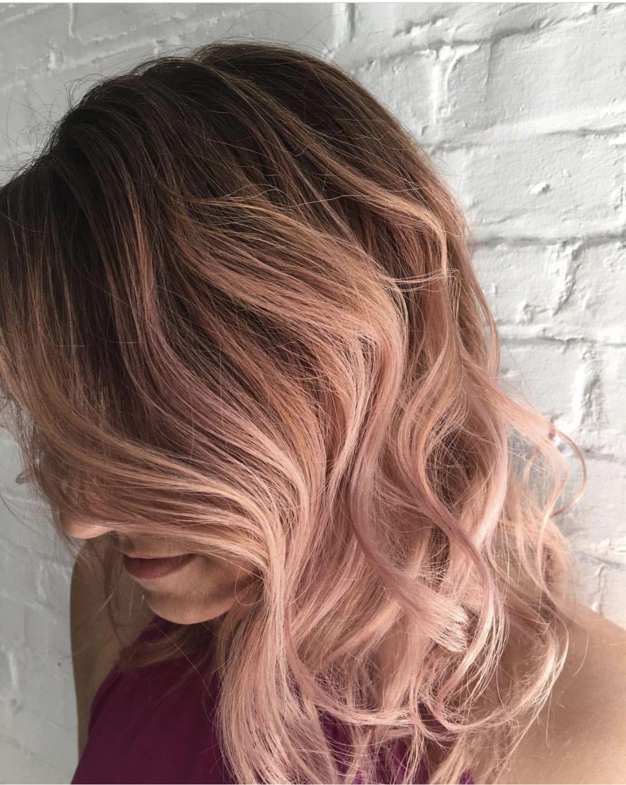 Rose gold hair blush blonde balayage lots of locks in
