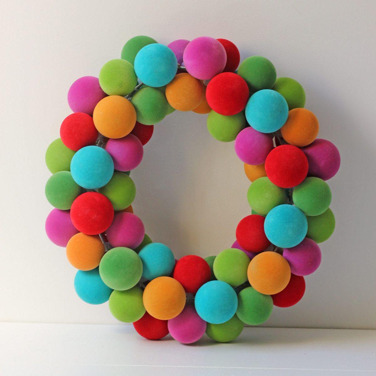 Love this Felt Ball Wreath - would make a great DIY project. #holidays #diy #christmas #wreath ...