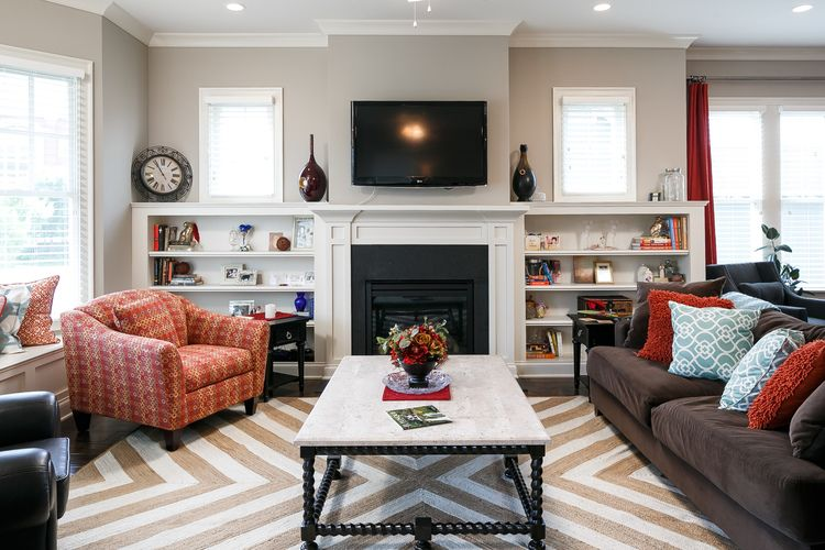 Great room with custom builtin shelves and fireplace with