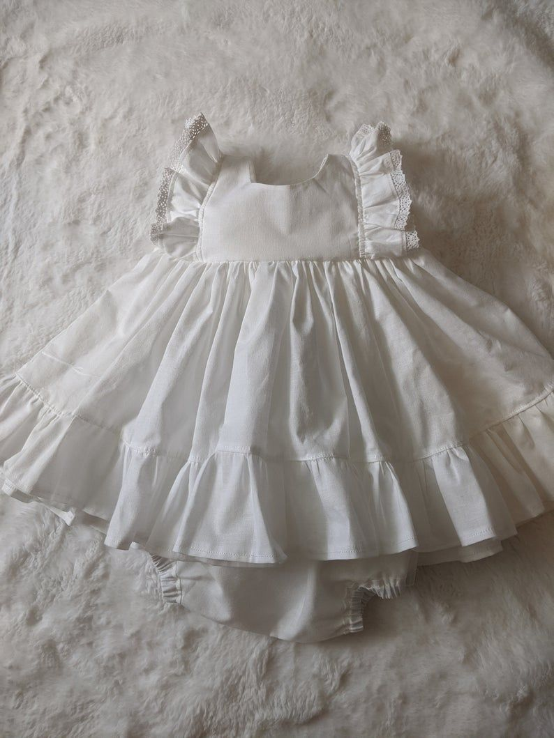 Baby Girl Cotton Dress In White With Lace Flower Girl Dress Girls Cotton Dresses Ruffle Flower Girl Dress White Flower Girl Dresses [ 1059 x 794 Pixel ]