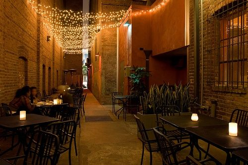 restaurant patio lighting String lights over patio dining area. patio Pinterest ...