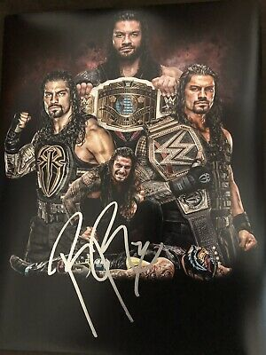ROMAN REIGNS Signed WWE 11x14 Photo Wrestler WWF Champion Autograph #1. Shipped with USPS First Class Package.