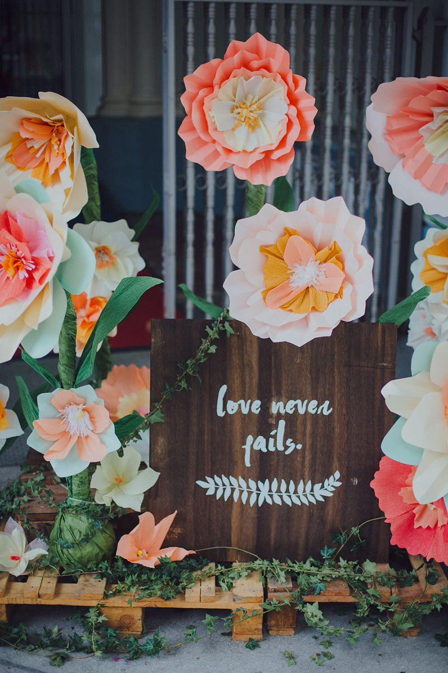 Adrian giacintas wedding with an oversized coral and pink paper a cheerful and chic free standing installation of oversized paper blooms dreamt up by in merry motion in the brides favourite shades of coral and pink mightylinksfo
