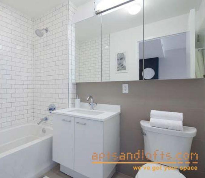 Half Tiled Bathroom, Long Medicine Cabinet Over Sink And Toilet