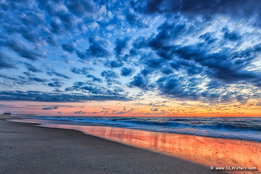 Sunrise at Kitty Hawk Fishing Pier on the Outer Banks of North Carolina.