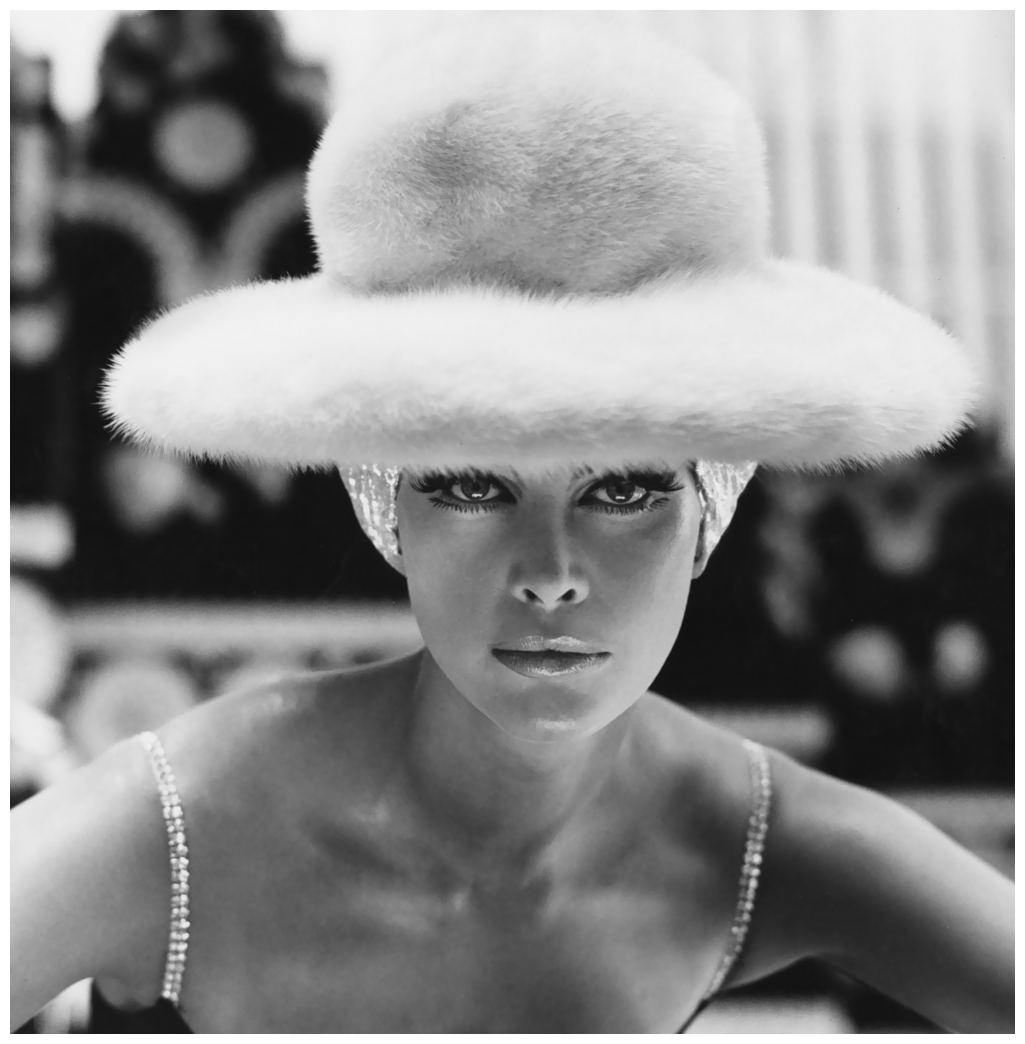 Turban of silver lame under a white mink hat, both by Otto Lucas, photo by Henry Clarke for Vogue UK 1965
