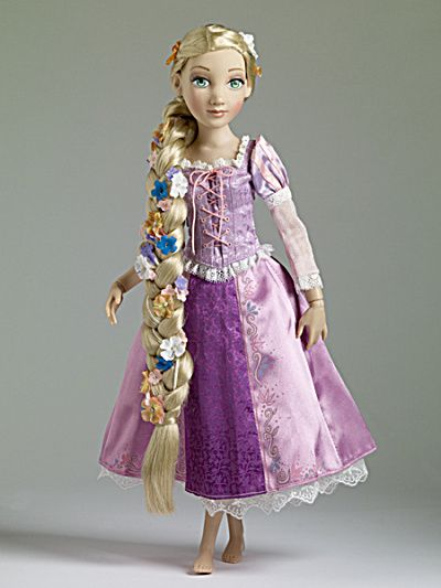 This is Tonner's 2012 version of Rapunzel from the Disney movie Tangled with very long braids intertwined with flowers. She is even lovelier than the 2011 doll (now sold out at this site that had unbraided hair). She is shipping from Tonner Doll Co. and expected so that she will be able to ship by Nov. 5, 2012. She will be $189.00.