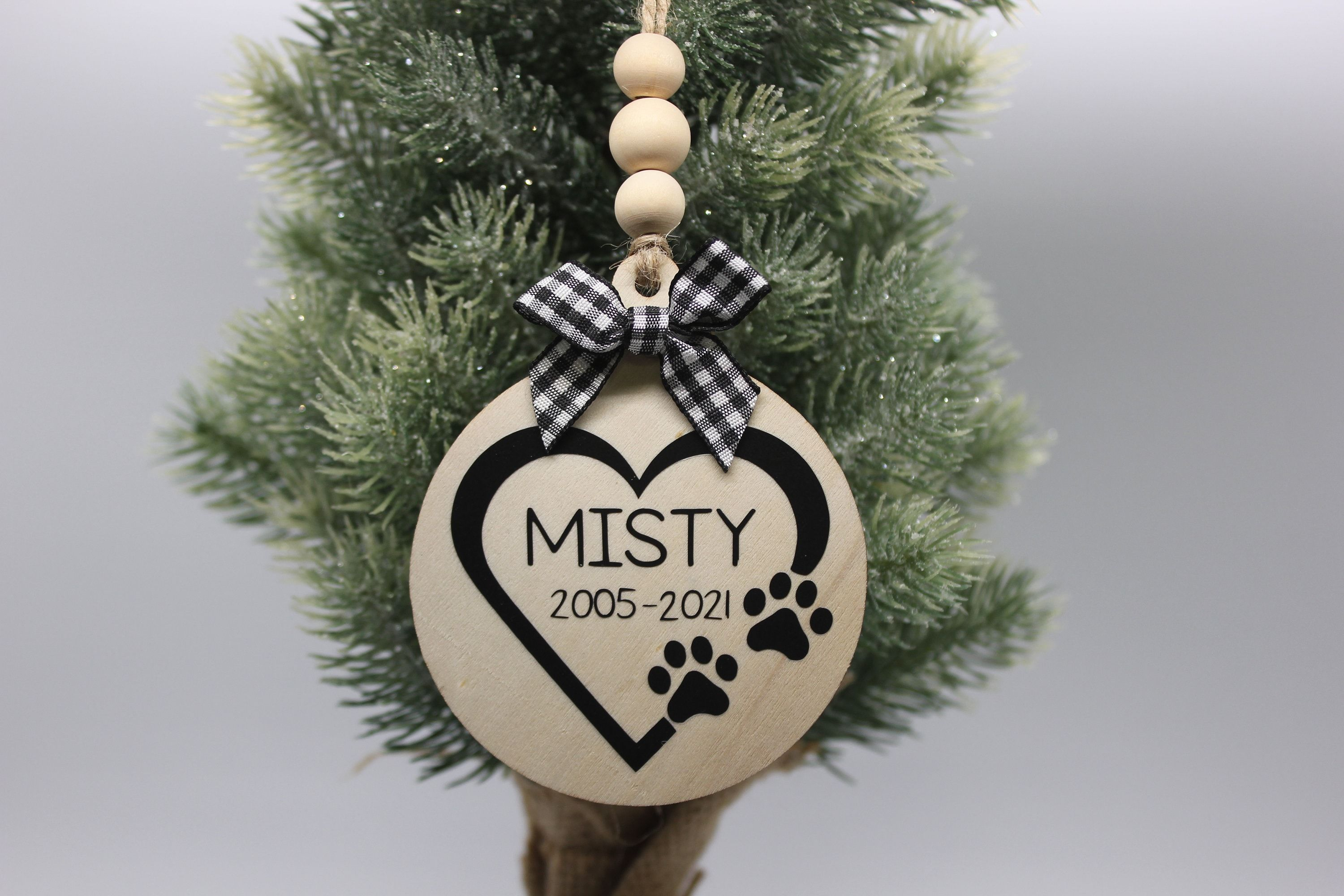 The ornament is made of a natural wood, heat transfer vinyl, ribbon, wooden beads, and lots of love:). They are approximately 2.7 - 3.5 inches in diameter and 2.5 mm thick. They come with jute twine string for easy hanging. All ornaments will come in a decorative bag for easy gift giving. *DISCLAIMERS* This is not a toy. For decoration only.