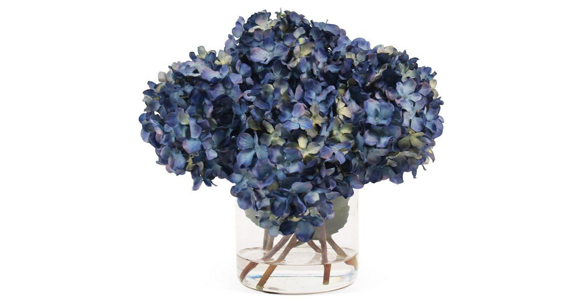 I got pin-happy on onekingslane.com  just loving these gorgeous faux hydrangeas as a piece to sit on a table near your navy couch!!!