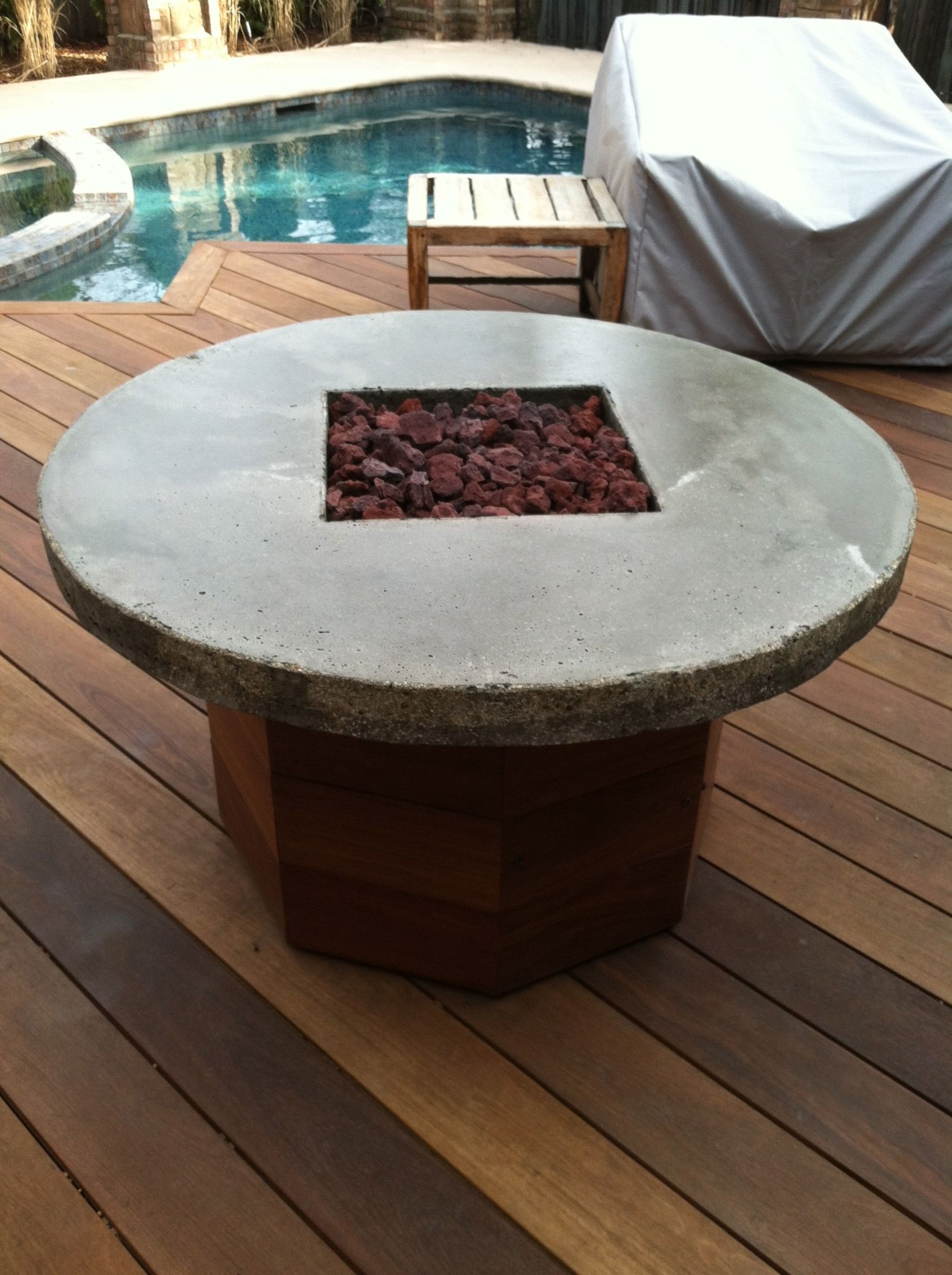 Ipe wood deck demands a custom ipe wood and concrete fire pit yes