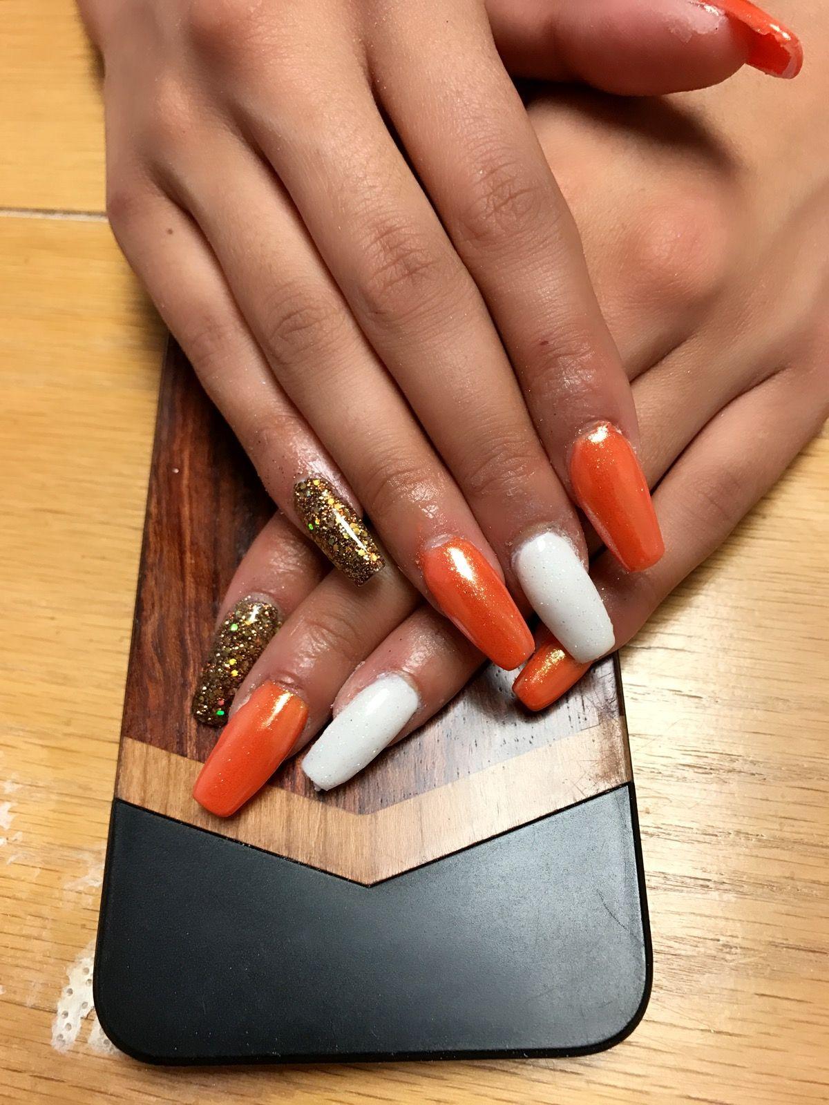 orange nails with hold chrome