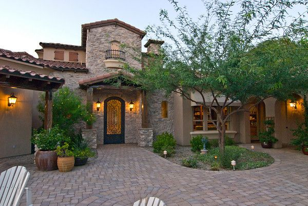Tuscan style frontyard ideas wrought iron gates add for Courtyard in front of house