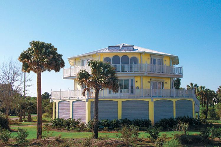 Our Two-story luxury stilt home design built oceanfront with ...