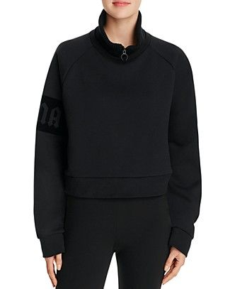 From arguably the most coveted collection of the season comes a too-cool take on the pullover from Fenty Puma x Rihanna. This oversize sweatshirt boasts a partial zip, plus a flocked logo at the arm t