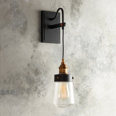 This factory chic fixture redefines lighting with high contrast black and metallic materials and an exposed filament bulb