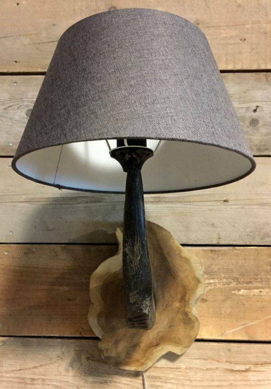 Wall lamp made of water buffalo horn. http://www.dejonginterieur.com ...