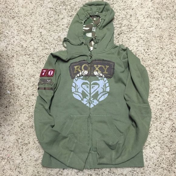 Barely used Roxy military inspired zip up hoodie. Very soft and comfortable army green with military print on inside of hood. Drawstring around hood and front kangaroo type pockets. Cute patches on right sleeve. Smoke free home. Roxy Tops Sweatshirts & Hoodies