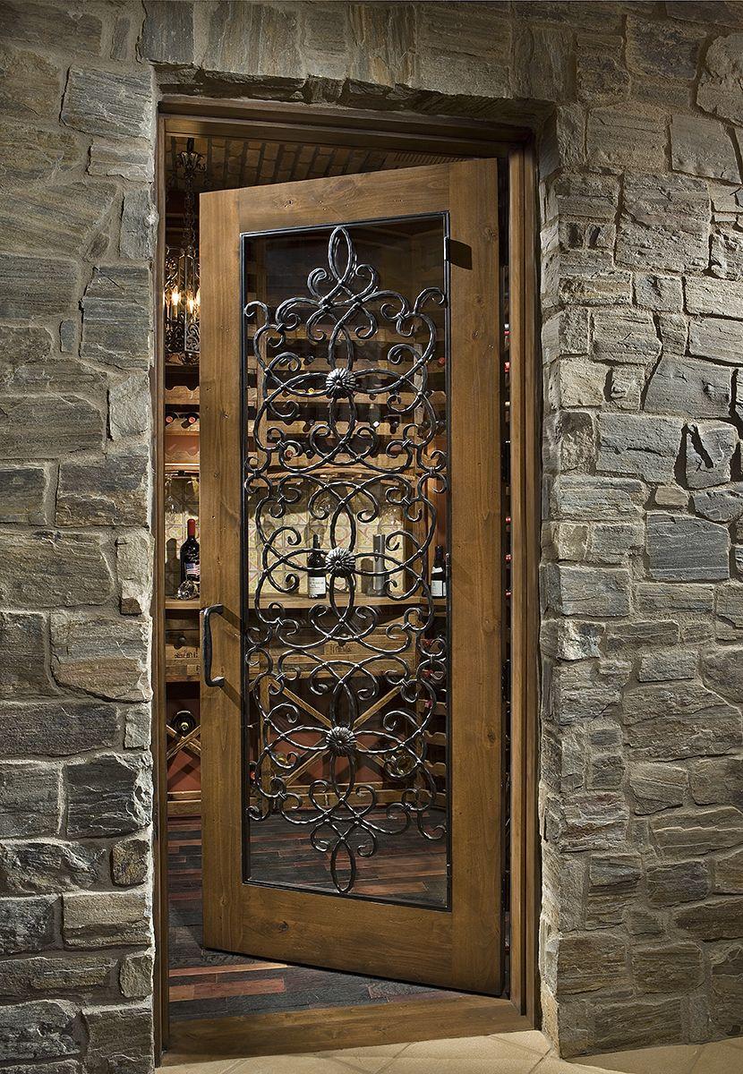 Custom wood wine cellar door with glass and iron work doorsbarn