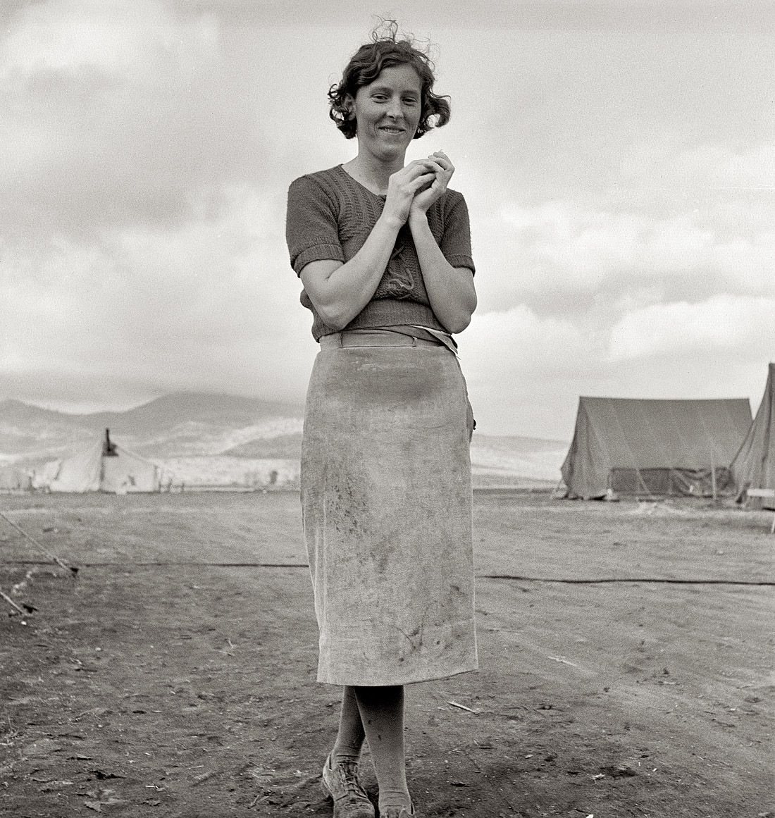 """October 1939. """"Young migrant mother has just finished washing. Merrill Farm Security Administration camp, Klamath County, Oregon."""" Medium format nitrate negative by Dorothea Lange for the FSA."""