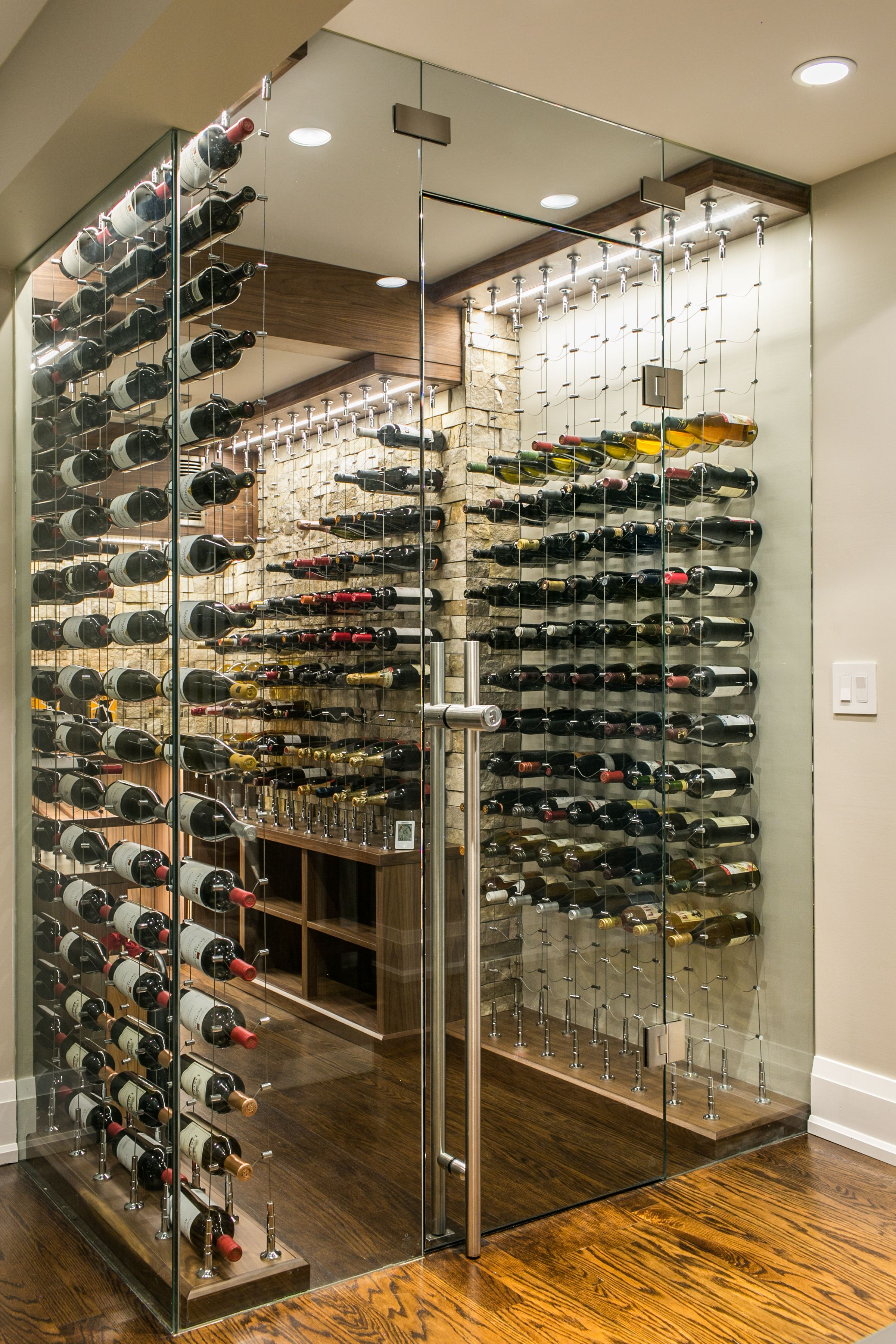 Custom Wine Cellar By Papro Wine Cellars Consulting Featuring The Cable Wine Sytem Glass Wine Cellar Wine Cellar Modern Home Wine Cellars