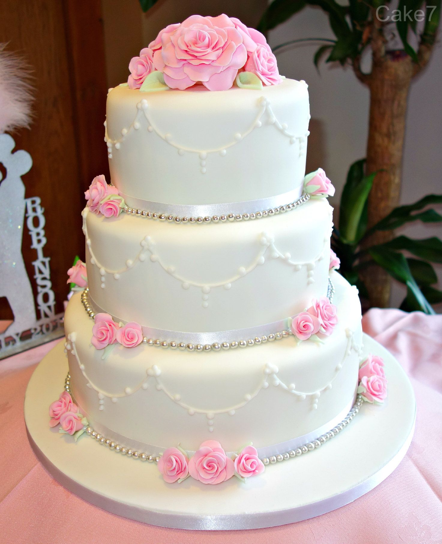Pink roses themed wedding cake. www.cakeseven.wix... Facebook- Cake7 ...