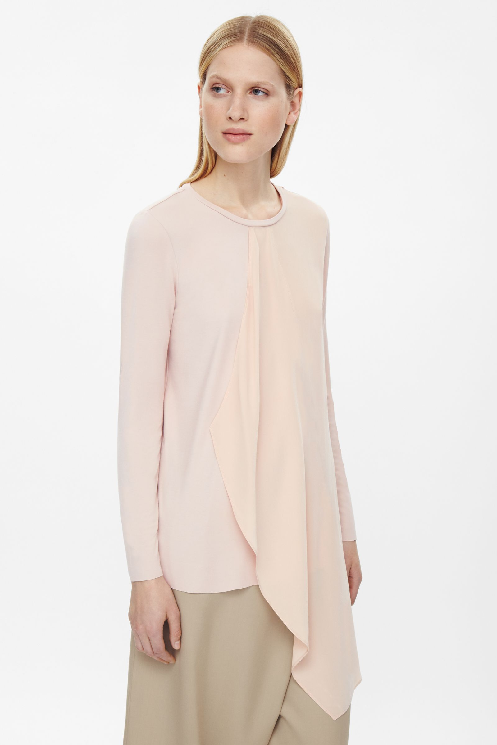 5feb3aecf7b3b This top is made from soft jersey and with an asymmetric silk drape detail.  An A-line fit