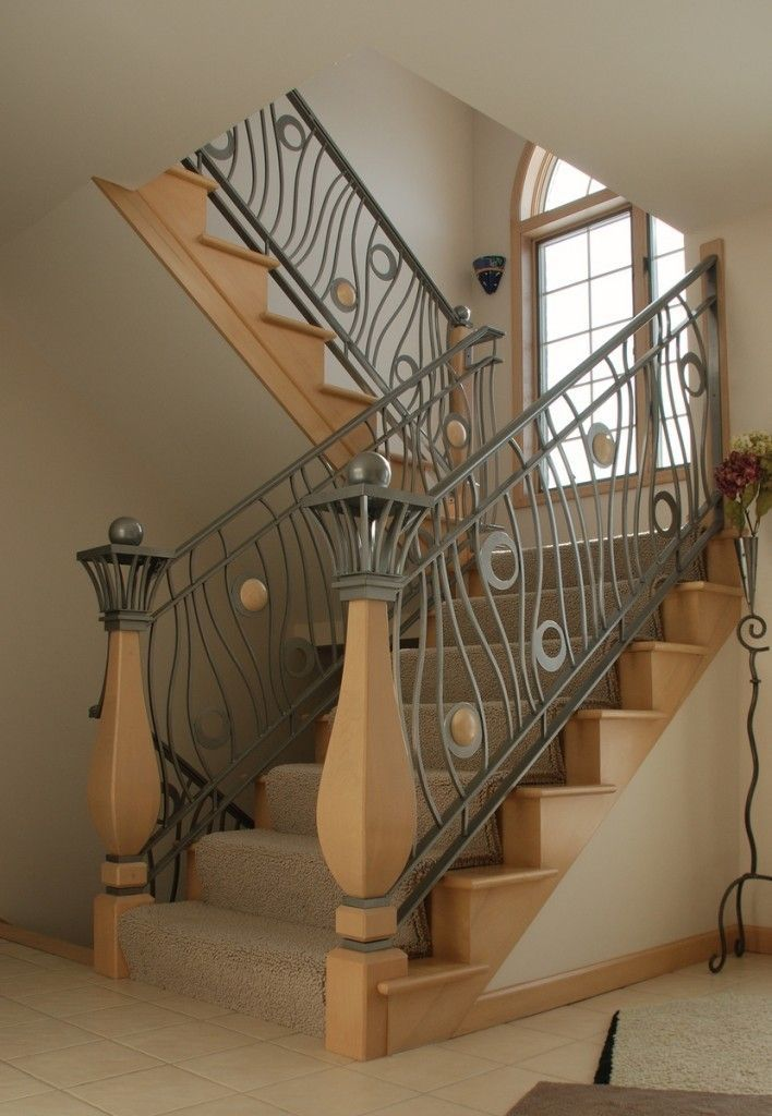 Exciting Stair Railing Design For Your Home With Gray Iron Baluster  Featuring Elegant Volute Newel And Beige Rug Tread Covers Of Fasu2026