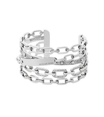 Our chain-link cuff takes accessorizing to the next level. To create this statement piece, we looked to the wrist-stack trend as inspiration. With edgy details and a silver-tone finish, it'll add dimension to any off-duty or evening look.