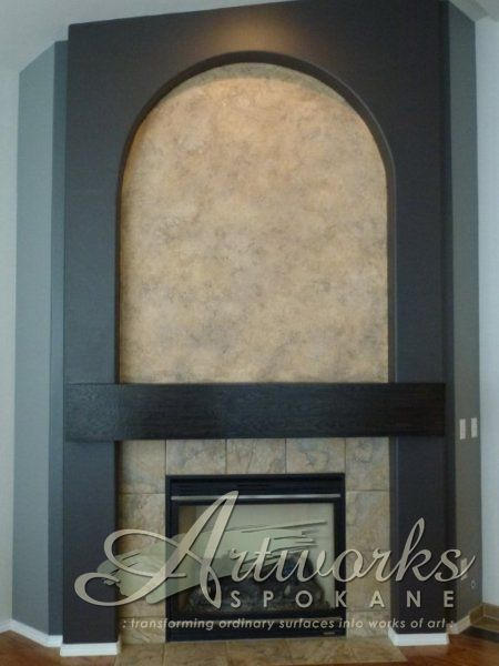 textured plaster wall in niche to coordinate with tile fireplace surround...gradated wall paint to enhance architectural details....new ebony stained oak mantle over drywall ledge
