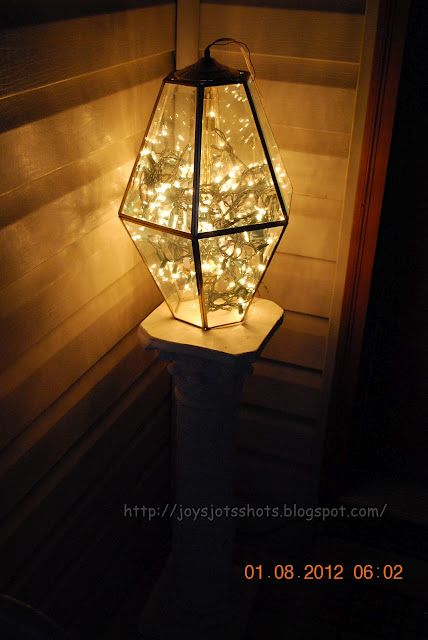 Use your Christmas lights in an old light fixture for your front