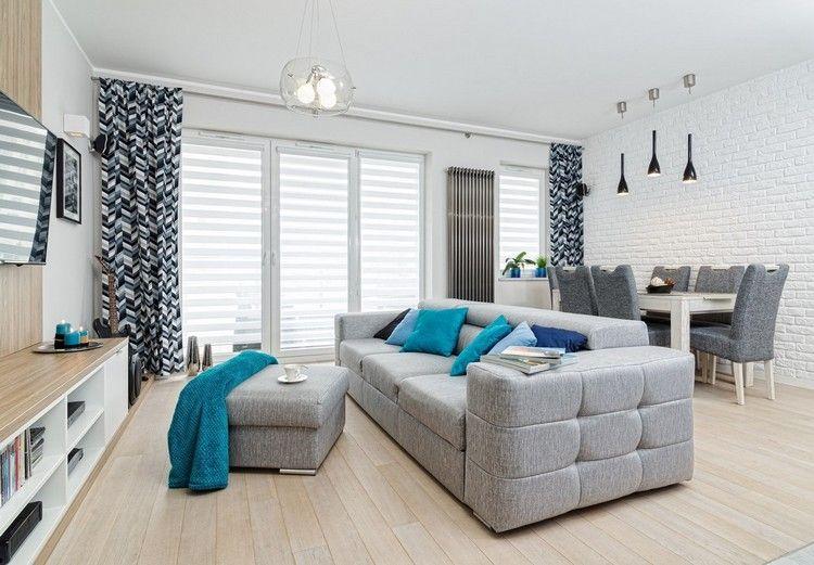 heller Holzboden, weiße Wände, graue Polstermöbel und Akzente in - wohnzimmer blau grau
