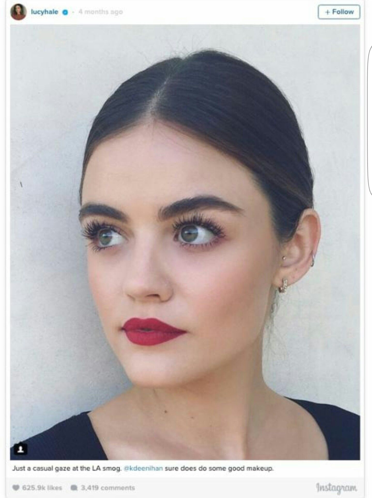 The Classic Red Lip Combined With Feathery Lashes Perfection