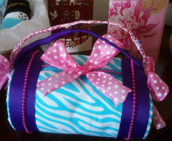Check out this item in my Etsy shop https://www.etsy.com/listing/223822057/cute-pink-purple-and-turquoise-zebra