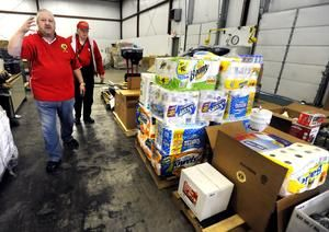 John Stalder (left) and Bud Wills of the Dover Lions Club walk through the Zimmer Warehouse, where local Lions Clubs accepted donations for victims of Hurricane Sandy on Thursday.