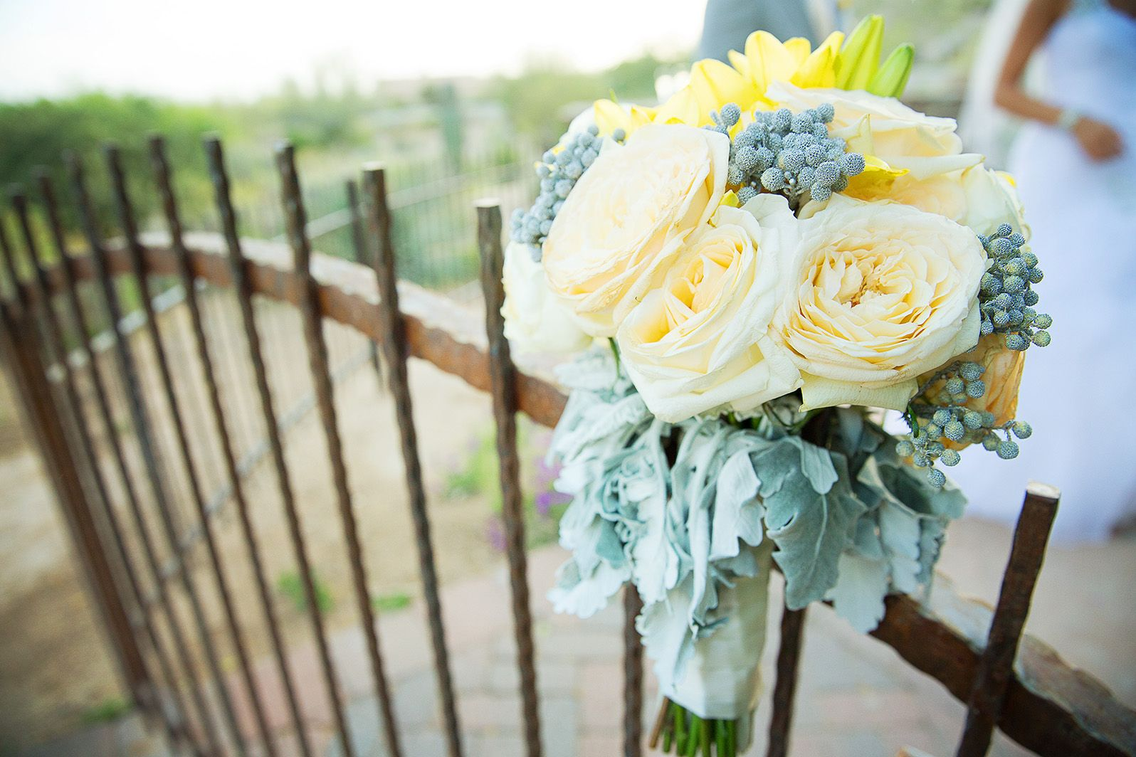 Bride's muted yellow and ivory rose bouquet Venue - Sassi Photographer - Terry McKaig #rusticwedding #yellowbouquet