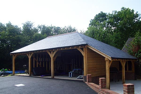 3 Bay Oak Garage With Fully Hipped Roof And Log Store